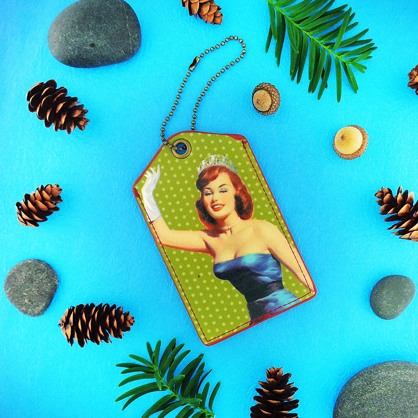 LAVISHY design & wholesale fun pinup girl vegan luggage tags to gift shops, clothing & fashion accessories boutiques, book stores and speciality retailers in Canada, USA and worldwide.