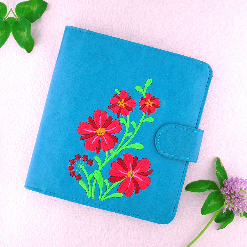 LAVISHY design & wholesale vegan embroidered passport wallets to gift shops, clothing & fashion accessories boutiques, book stores and speciality retailers in Canada, USA and worldwide.